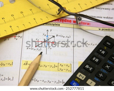 Graphs and charts of vectors (vector) theory together with glasses, calculator and wooden pencil - stock photo