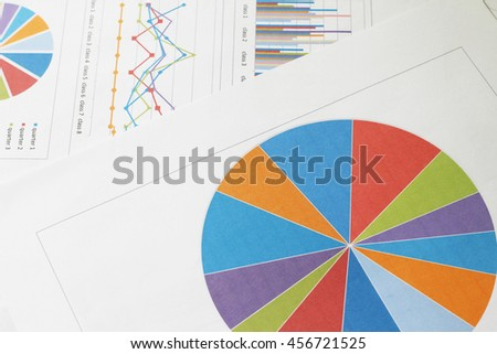 Graphs and charts on business table. The workplace of business people. - stock photo