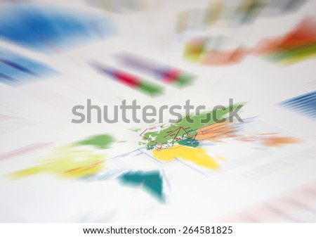 Graphs and charts on the table, motion blur - stock photo