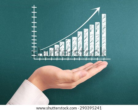 Graphs on the hand, meeting concept - stock photo