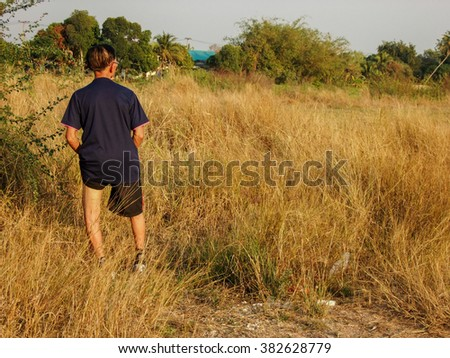 grass and sunshine person - stock photo