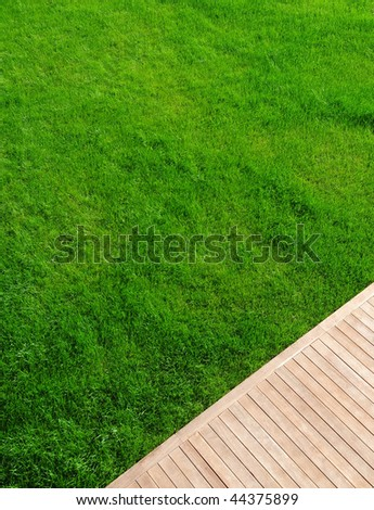 grass and teak wood at the garden