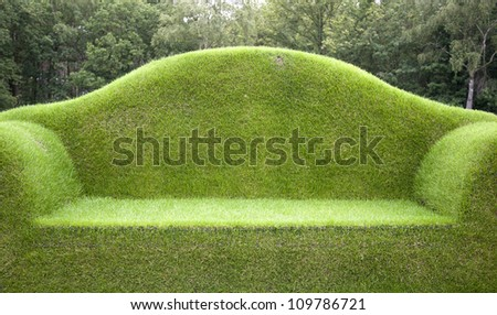 Grass bench - stock photo