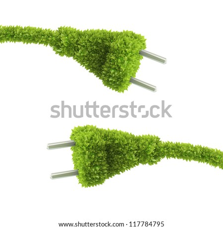 Grass covered electrical plug - renewable energy concept - stock photo