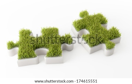 Grass covered puzzle pieces - ecology development concept - stock photo