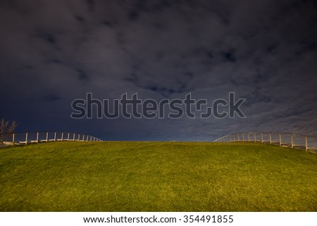 grass covered roof at night - stock photo