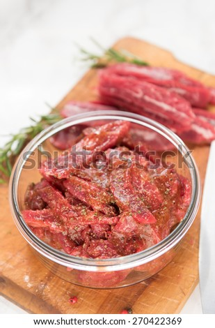 Grass Fed Flank Steak Sliced and Mixed with Marinade to Make Beef Jerky