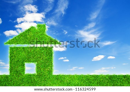 Grass home icon from grass background - stock photo