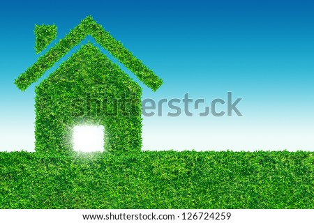 Grass home icon from grass on blue sky background - stock photo