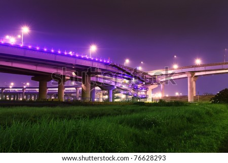 Grass Land under the High Way express Bridge at a cloudy night, Taipei, Taiwan - stock photo