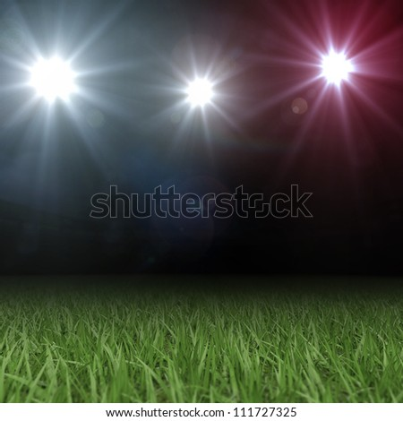Grass Playing Field 3D under colored Spotlights - stock photo