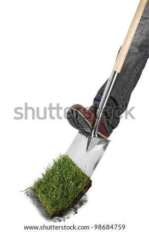 Grass with a spade and foot - stock photo