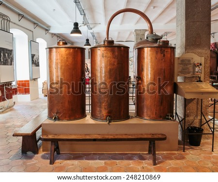 GRASSE, FRANCE - OCTOBER 31, 2014: Ancient distiller for the production of perfume in Fragonard factory in Grasse - stock photo