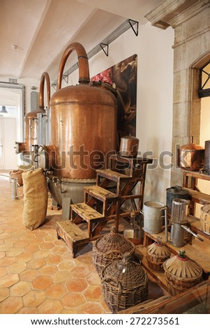 GRASSE, FRANCE - OCTOBER 31, 2014: Ancient distiller for the production of perfume in Fragonard factory in Grasse, France - stock photo