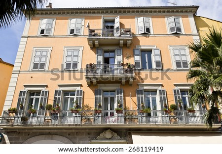 GRASSE, FRANCE - SEPTEMBER 9, 2014: Vintage building with beautifully decorated windows in the Southern France town of Grasse, the world capital of perfume.  - stock photo