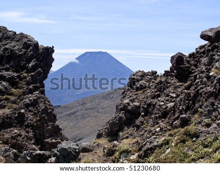 Grasses frame the volcano that was Mount Doom in Mordor in Lord of the Rings - stock photo