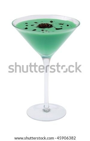 Grasshopper mixed drink with shaved chocolate garnish on white background - stock photo