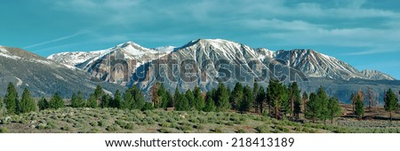 Grassland and snow mountain panorama with cloud in Yosemite. - stock photo