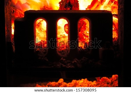 Grate boiler furnace with coals inside. Closeup. - stock photo