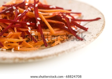 grated beetroot and carrot with sesame - stock photo