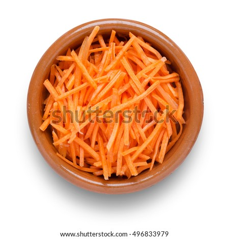 Grated carrot in small brown rustic bowl, shot from directly above isolated on white background with path