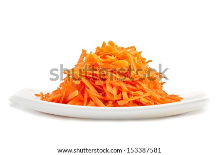 Grated carrots at  plate isolated on white background - stock photo