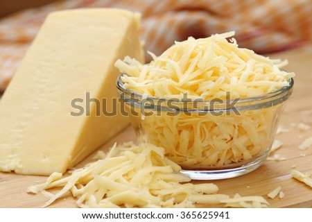 Grated cheese in a glass bowl - stock photo