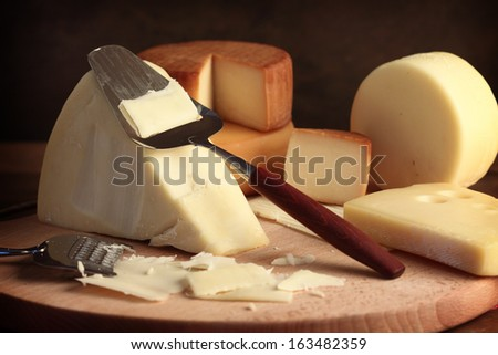 Grated cheese with grater, close up  - stock photo