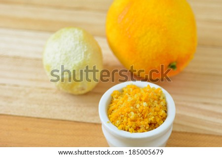 Grated citrus (orange and lemon) rind. cooking ingredient. copy space - stock photo