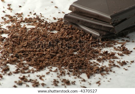 Grated dark chocolate and few chocolate pieces. - stock photo