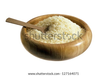 grated Parmesan cheese in a wooden plate - stock photo