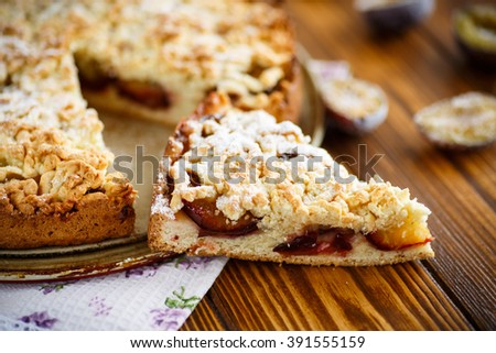Grated pie with fruit  - stock photo