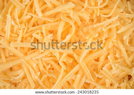 Grated pizza cheese close up texture - stock photo