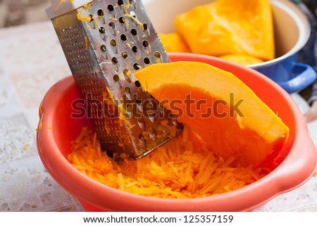 Grated pumpkin for a pie - stock photo
