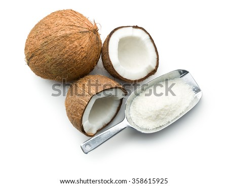 grated, whole and halved coconut on white background - stock photo