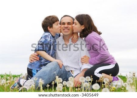 Grateful children giving their father a kiss - stock photo