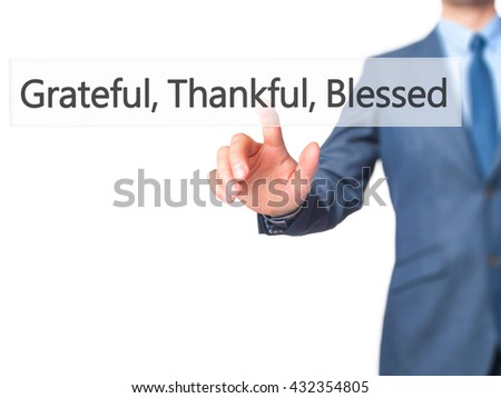 Grateful Thankful Blessed - Businessman hand pressing button on touch screen interface. Business, technology, internet concept. Stock Photo