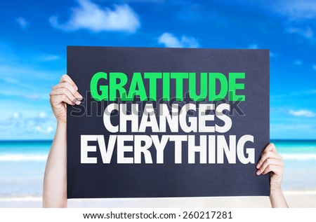 Gratitude Changes Everything card with beach background - stock photo