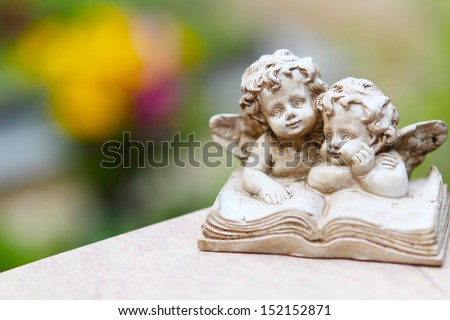 Grave angel before blossoms - stock photo