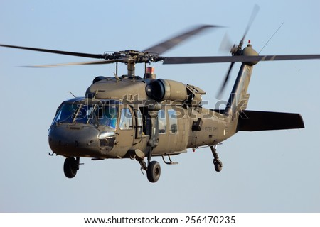 GRAVE, NETHERLANDS - SEP 17: American Black Hawk helicopter takes off at the Operation Market Garden memorial on Sep 17, 2014 Grave, Netherlands. Market Garden was a large Allied operation in 1944. - stock photo