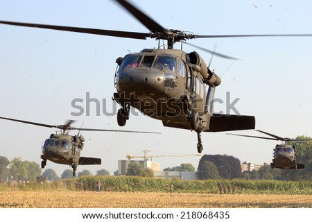 GRAVE, NETHERLANDS - SEP 17: American Black Hawk helicopters take off at the Operation Market Garden memorial on Sep 17, 2014 Grave, Netherlands. Market Garden was a large Allied operation in 1944. - stock photo