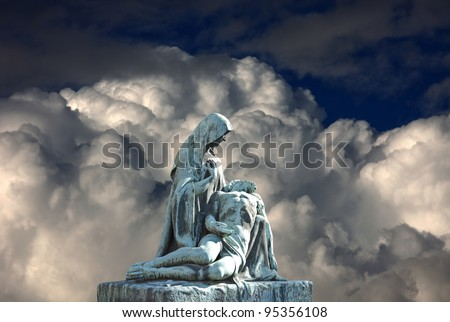 Grave pieta scene with death Jesus Christ. Religious art. Vysehrad Slavin Cemetery, Prague, Czech Republic - stock photo