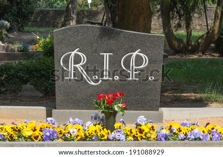 Grave stone with the word RIP / cemetery - stock photo