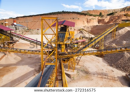 Gravel aggregate extraction  - Machinery distribution and classification by size gravel quarry or gravel pit at outdoor  - stock photo