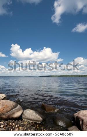 Gravel coast  Stony shore of Ladoga lake, Russia - stock photo