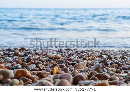 Gravel Depth Of Field and blue sea background.
