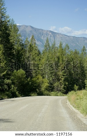 gravel logging road - in the kootenay rockies, BC, canada - stock photo