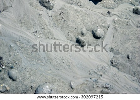 Gravel of mud and stream in dirt of Alaska. - stock photo