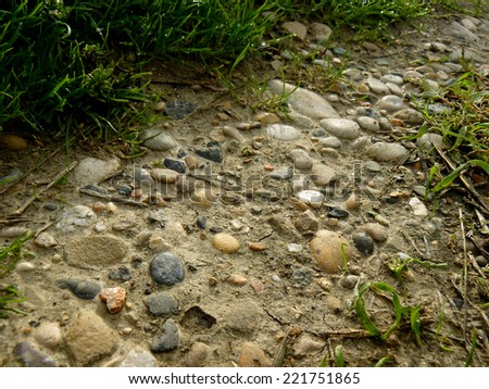gravel path among the grass - stock photo