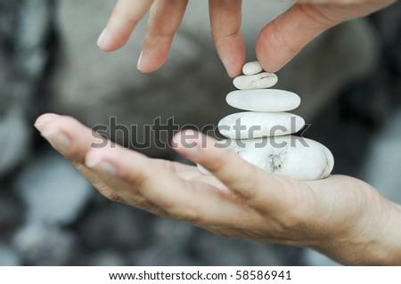 Gravel pile in hands - stock photo